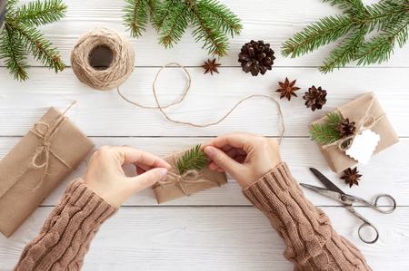 pinecones: Preparation christmas gifts on a white wooden table with fir branches Stock Photo