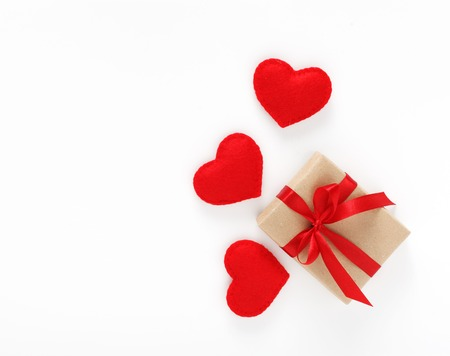 Valentine's day card with gift are red hearts isolated on white background with copyspace