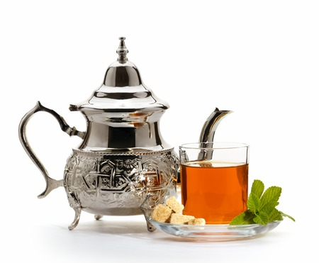 Traditional moroccan teapot with glass of green tea isolated on white background Stock Photo