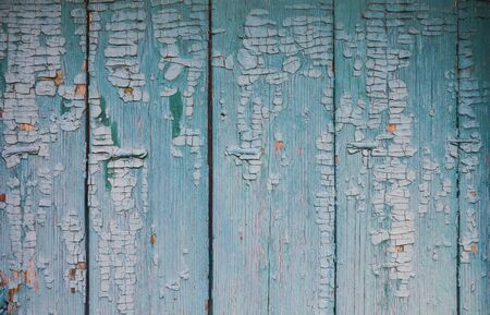 Blue wooden background. Blue faded painted wooden texture, background, wallpaper. Wooden background, painted surface blue boards. Weathered blue wood background texture. Horizontal planks