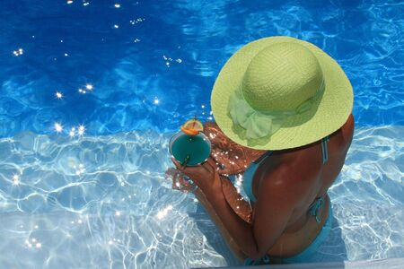 Young woman enjoying a swimming pool Stock Photo - 3564361
