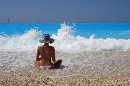 Pretty blonde woman enjoying the Ionian sea in Greece photo