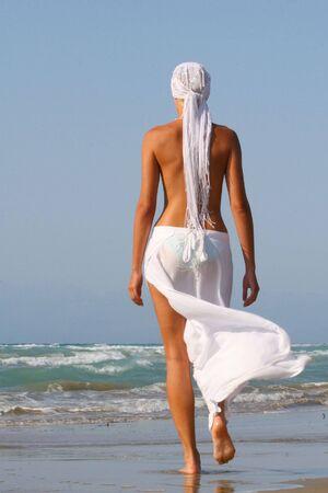 Pretty blonde woman enjoying the Ionian sea in Greece Stock Photo - 3661780