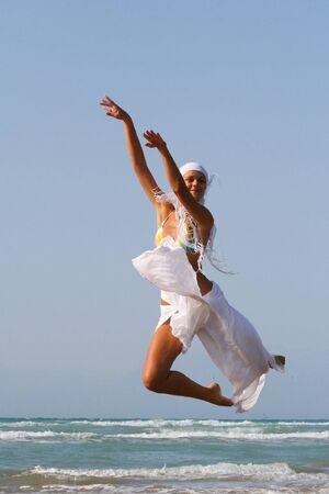 Pretty blonde woman enjoying the Ionian sea in Greece Stock Photo - 3661772