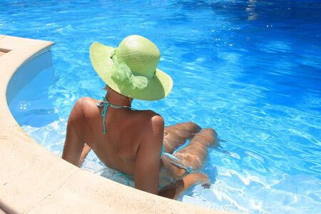 Young woman enjoying a swimming pool Stock Photo - 3661929