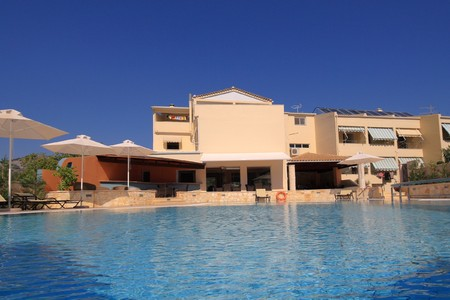 Exterior of a hotel in Greece photo