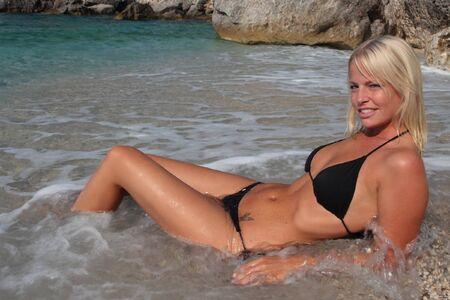bikini butt: Pretty blonde woman enjoying the Ionian sea in Greece