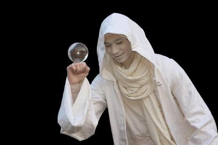 White Wizard manipulating Crystal balls isolated on black background. photo
