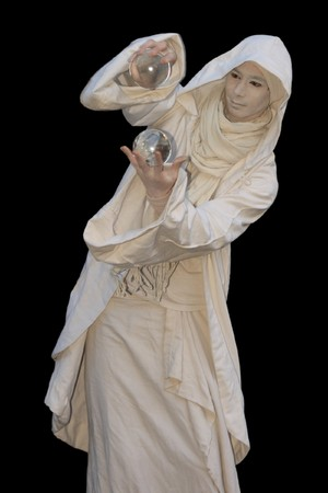 White Wizard manipulating Crystal balls isolated on black background. Stock Photo - 4356664