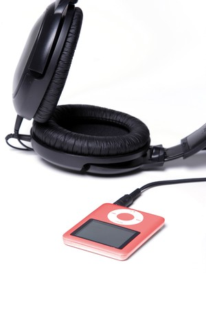 Red MP3 Player with huge headphones photo