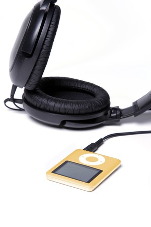 Orange MP3 Player with huge headphones photo