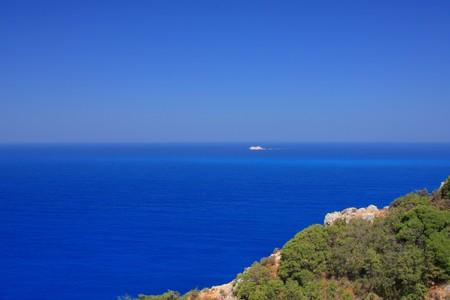 bu: Ferry boat passing bu the Porto Katsiki beach on the Ionian island of Lefkas Greece