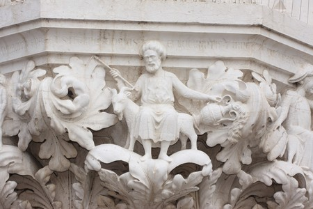 Details of a sculpture on Piazza San Marco and The Doges Palace, Venice, Italy photo