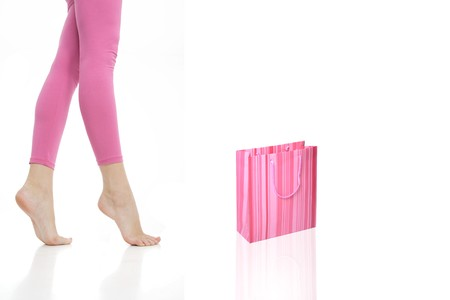 waist-down view of woman with a shopping bag Stock Photo - 4554517