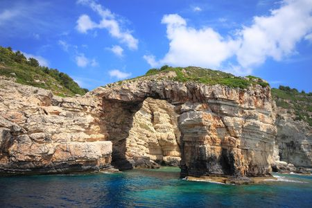 hillside: one of the caves of anti Paxos island Greece     Stock Photo