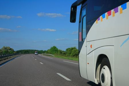 Bus riding fast on the highway