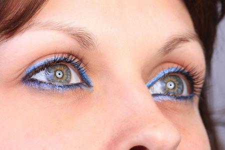 dilate: beautiful woman`s open eye