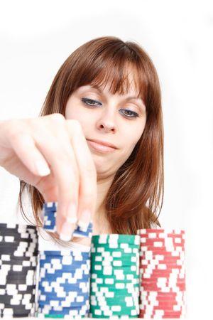 Beautiful Young Woman playing poker photo