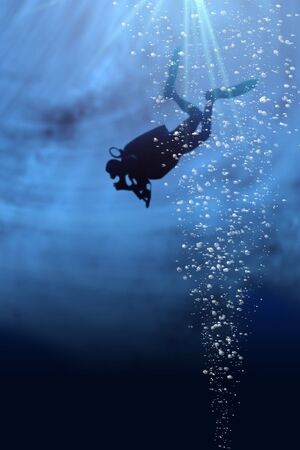 deep sea: Silhouette of a diver in blue sea