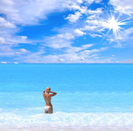 Beautiful young woman enjoying the Ionian sea in Greece photo