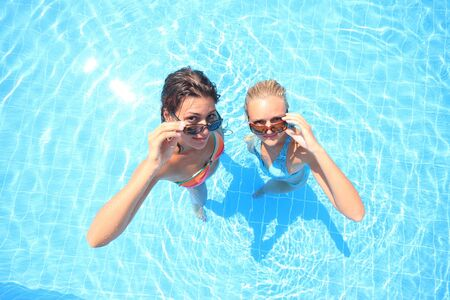 Two models in a pool in Greece   photo