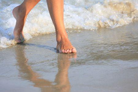 nice legs: nice legs of a pretty girl walking in water