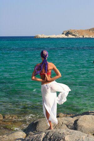 Beautiful girl meditating on the beach in Greece Stock Photo - 5414382