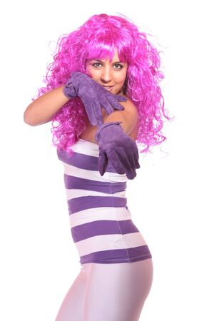 Portrait of a young woman, making a silly face, with pink wig photo