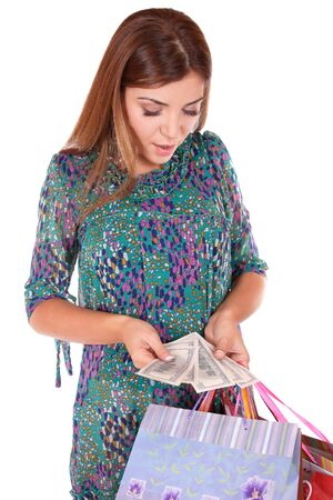 isolated portrait of a beautiful caucasian woman with some shopping bags and dollars in her hands photo