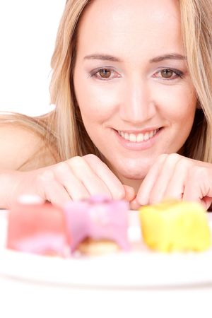 Attractive woman with a cake. Close-up portrait. isolated on white   photo