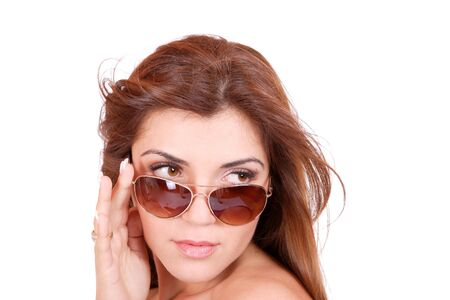 Beautiful young Woman wearing sunglasses isolated on white background   photo