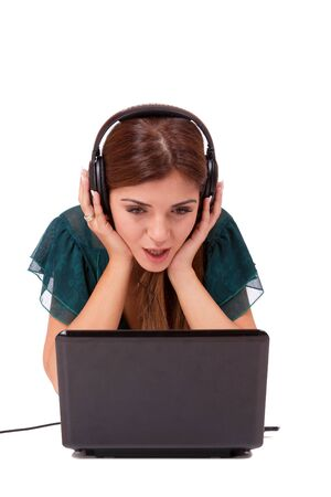 Beautiful young woman  Listening to Music on her laptop   photo