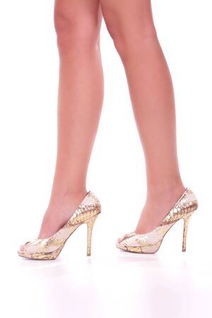 Legs with high heels isolated against a white background  Stock Photo - 5855892