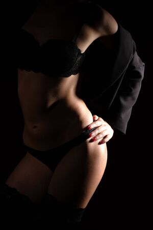 glamour woman in lingerie on dark background  Stock Photo - 5842528