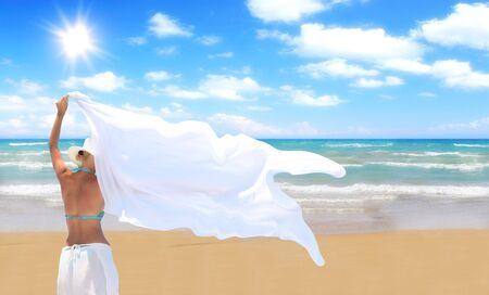 woman on the beach with a white sarong   photo