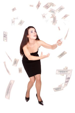Beautiful woman on white background with hundred  dollars bills falling around her     photo