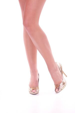 Legs with high heels isolated against a white background  Stock Photo - 5947292