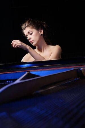 symphonic: A beautiful young woman playing piano