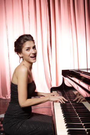 A beautiful young woman playing piano