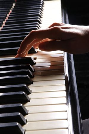 keyboard player: A  young woman playing piano closeup