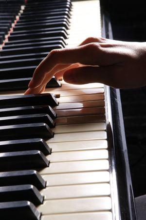 melodic: A  young woman playing piano closeup