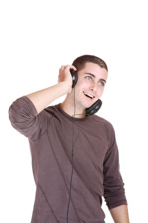 Man is listening to the music over white background Stock Photo - 6146648