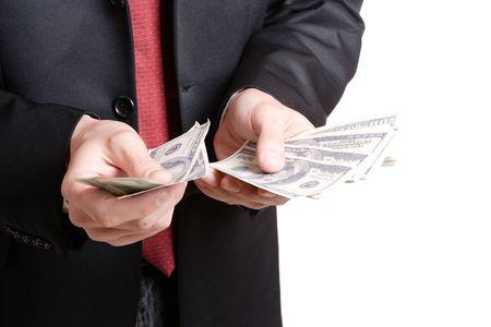 A Businessman Holding Money on white background   Stock Photo