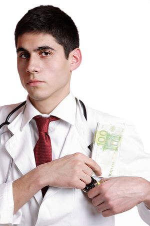 doctor with dollars: Doctor with 100 dollars bills in his pocket