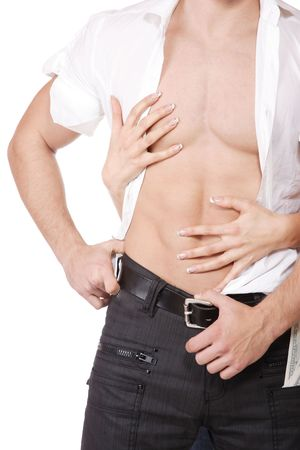 Womans hands on a sexy mans torso     Stock Photo