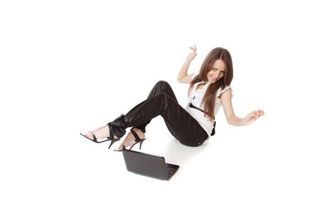 girl lying studio: Portrait of an adorable casual woman with a laptop, working on the floor.