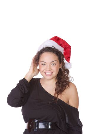 A young woman smiling wearing christmas hat.  Stock Photo - 6096885