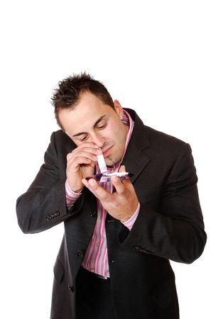 druggie: Giovane imprenditore sniffare cocaina su un CDDVD  Archivio Fotografico
