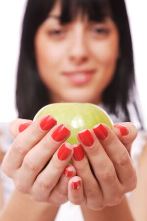 A pretty young woman holding an apple shes about to eat   photo
