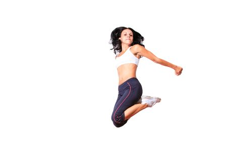 Young woman jumping while exercising Stock Photo - 6278816